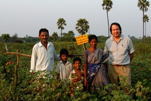 With Yaku and family. Yaku had us stand where viewers could see three elememnts of organic farming: a bird perch, pheromone trap, and marigolds. Andhra Pradesh, 2005.